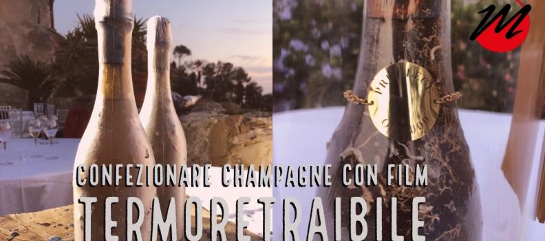 Confezionamento bottiglie di Champagne con film termoretraibile